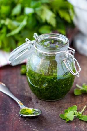 Green tasty herb sauce marinade from oregano, parsley, oil, trad