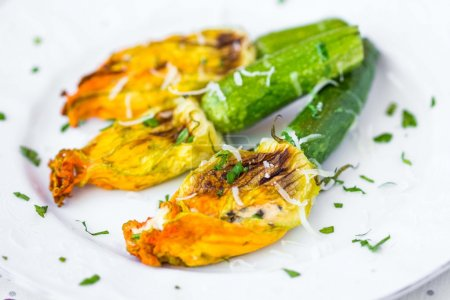 Fried zucchini flowers stuffed with cream cheese, ricotta, tasty