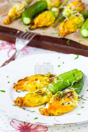 Fried zucchini flowers stuffed with cream cheese, ricotta, tasty