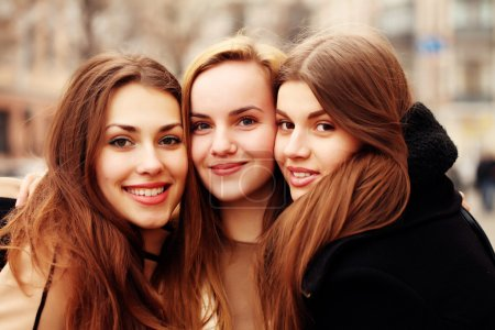 Photo for Holidays, tourism and happy people concept - three smiling women in the city. - Royalty Free Image