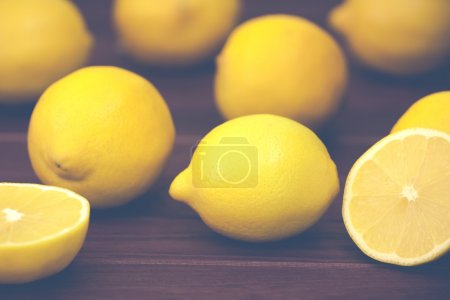 Photo for Yellow lemons on a wooden board in the style of Instagram - Royalty Free Image