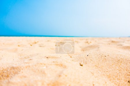 Photo for Selective focus point on sand with beautiful tropical sea and beach landscape - Royalty Free Image
