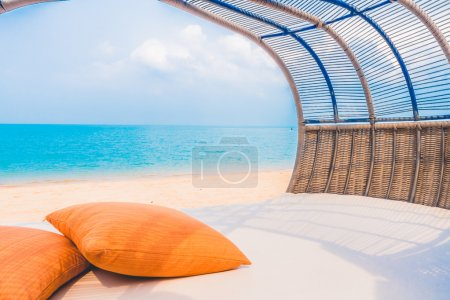 Luxury deck with pillow on the beach and sea