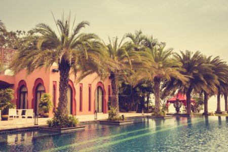 Photo for Beautiful luxury vintage swimming pool in hotel pool resort, Vintage Filter - Royalty Free Image