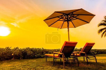 Empty umbrellas and chairs at Twilight Times