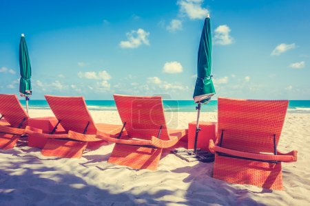 Umbrellas and chairs on beach