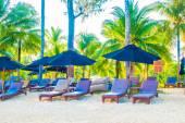 Umbrella and chair on tropical beach