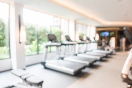 Abstract blur fitness and gym room interior for ba...