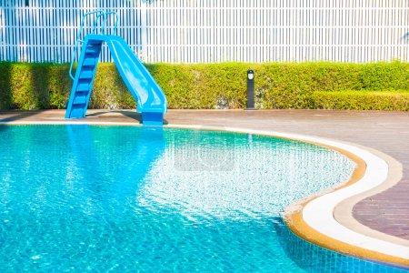 Slider around swimming pool