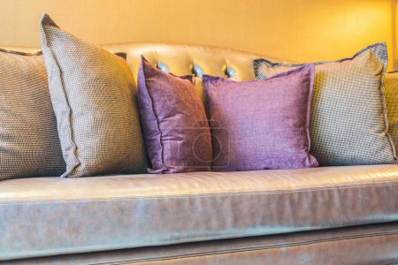 Photo for Beautiful luxury pillow on leather sofa decoration in living room interior - Royalty Free Image