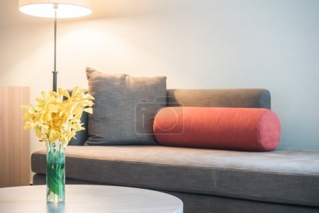 Photo for Sofa with light lamp and vase flower decoration interior of room - Royalty Free Image