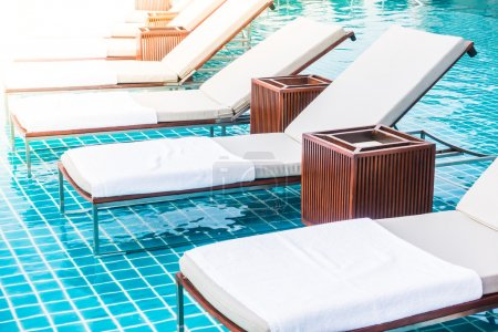 luxury chairs around swimming pool