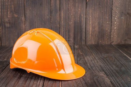 Photo for Construction hard hat on wooden background - Royalty Free Image