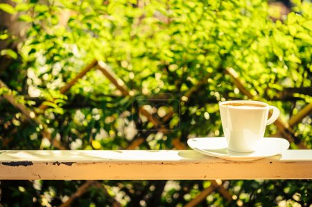 Photo for Outdoor Coffee cup with sun light - vintage effect process style pictures - Royalty Free Image