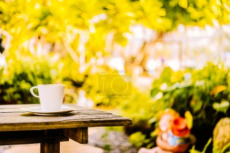 Photo for White coffee cup latte on wooden table - vintage sunlight effect style pictures - Royalty Free Image
