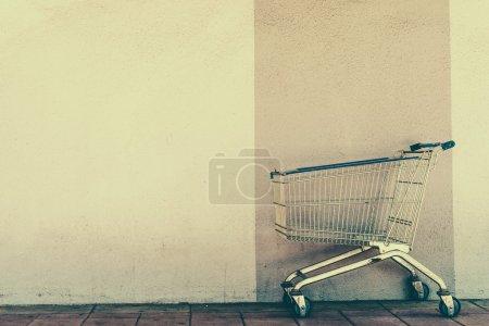 Shopping cart near wall