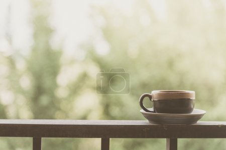 Coffee cup on balcony