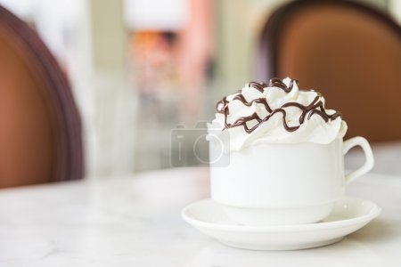 Hot chocolate cup with whipped cream