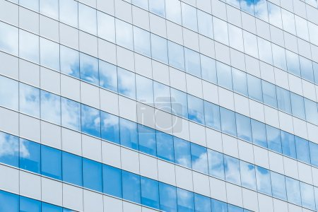 sky with clouds reflecting in windows
