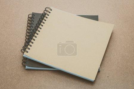 Notebooks mock up on wood
