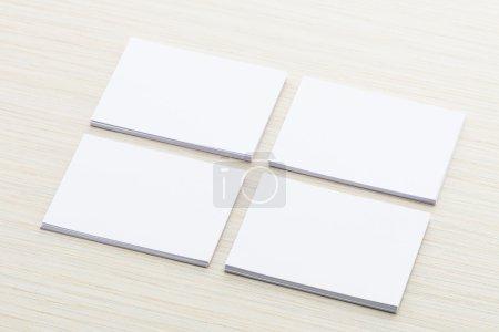 Photo pour Livres blancs maquettes sur fond de bois - image libre de droit
