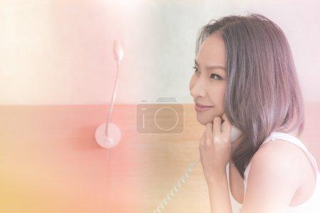 asian woman calling telephone