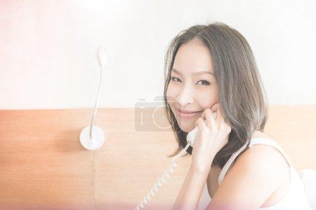 woman calling telephone