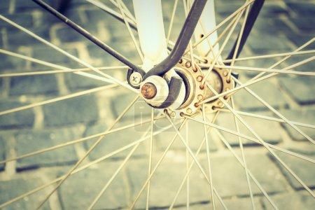Photo pour Point de mise au point doux sur pignon sur roue de vélo, Filtre Vintage - image libre de droit