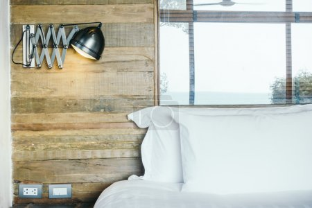 White pillows on bed in bedroom