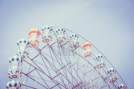 Photo for Vintage ferris wheel on blue sky background in the park, Vintage Filter - Royalty Free Image