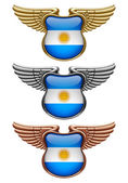 Gold silver and bronze award signs with wings and Argentina fla