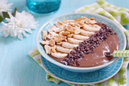 Peanut butter chocolate smoothie with banana and n...