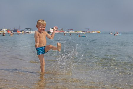Happy kid playing on a beach