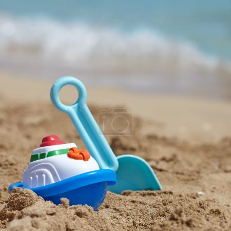 Photo for Summer family vacations concept. Childrens toys on a sand beach - Royalty Free Image