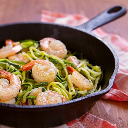 Photo for Low carb zucchini spaghetti with shrimp in a pan - Royalty Free Image