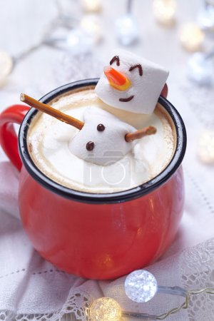 Photo for Red mug with hot chocolate with melted marshmallow snowman - Royalty Free Image