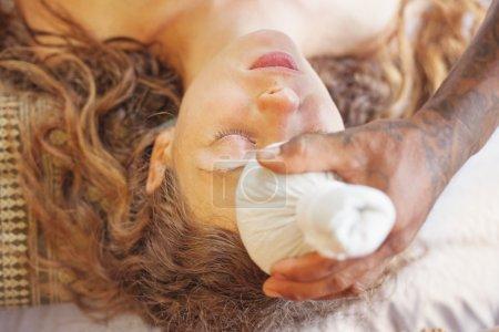 woman getting herbal massage