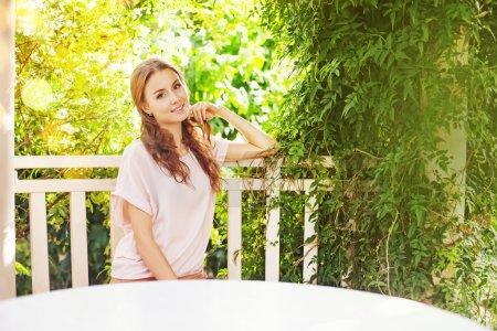 Beautiful woman near the blank table