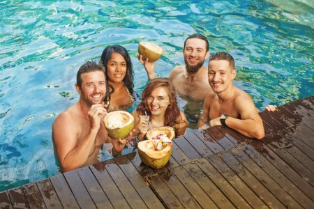 people having party in the pool