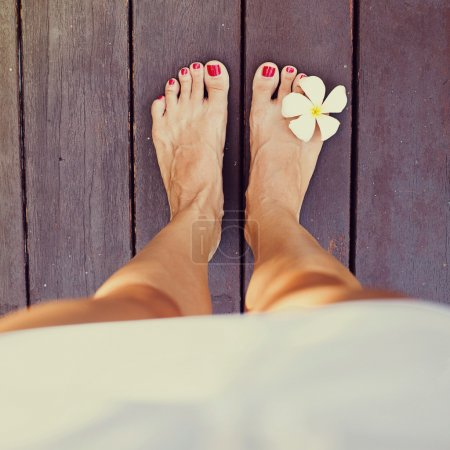 Bare feet  with flower