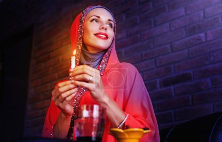 muslim woman holding candle