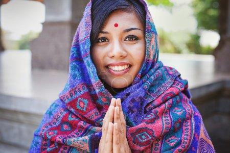 woman performing namaste gesture