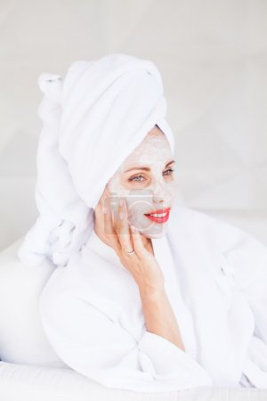 woman doing face mask