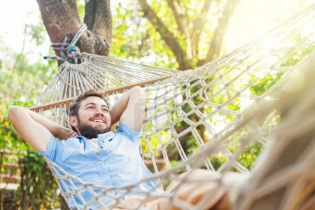 Photo for Young man lying in hammock on the nature - Royalty Free Image