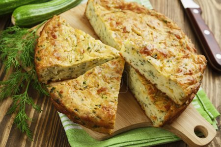 Zucchini pie with cheese and herbs