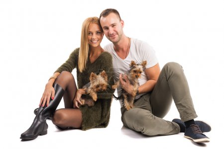 Couple with two yorkshire terriers
