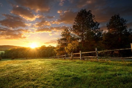 Fenced ranch at sunrise