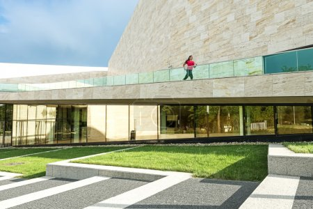 Woman running on modern building
