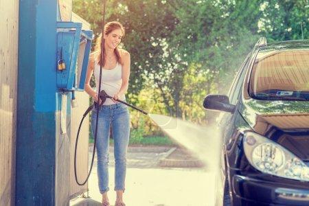 Pretty woman  washing  car...