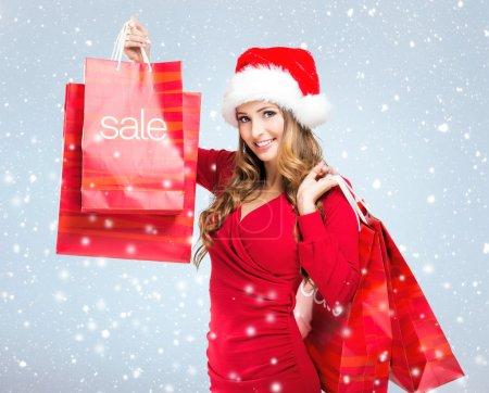 Woman with SALE bag
